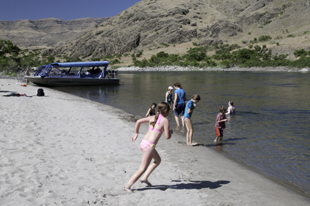 Passengers on a Jet Boat tour take time out for a swim in the Snake River.